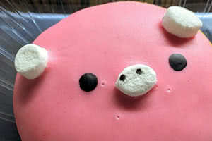 Raspberry Filled Piggy Donut